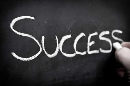 Hand writing success on blackboard Stock Photo - 10869844