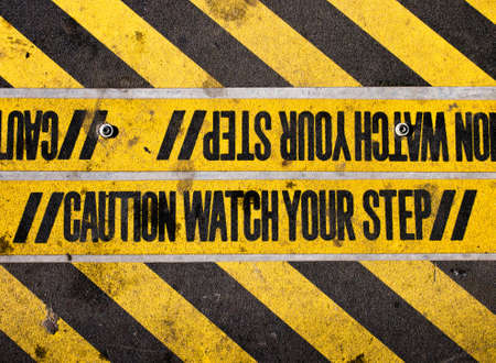 Watch your step yellow and black warning