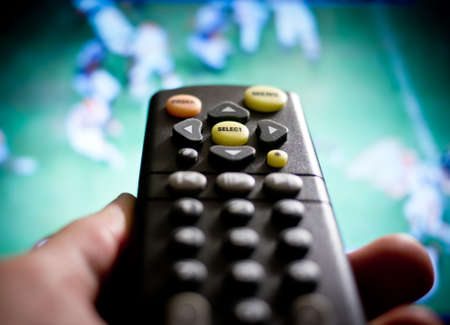 Watching sports  football on television photo