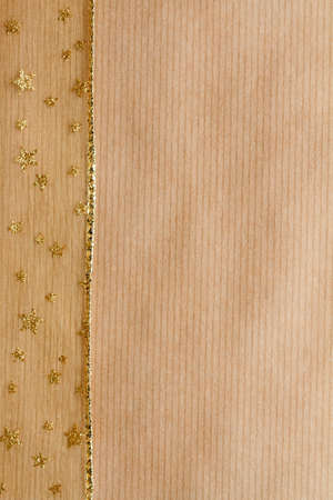 Brown paper background with gold ribbon photo