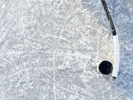 Hockey stick and puck photo