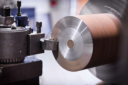 industrial machinery: Lathe cutting metal Stock Photo