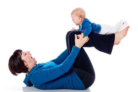 Yoga with infant girl Stock Photo