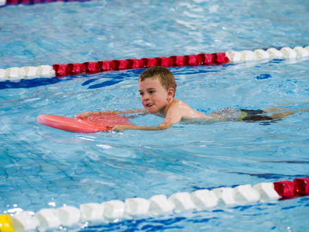 Boy racing in triathlon photo