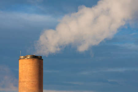 Smokestack with steam Banco de Imagens