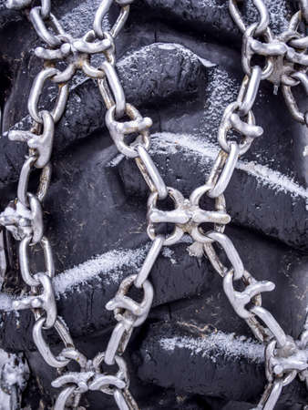 traction: Tire chains Stock Photo