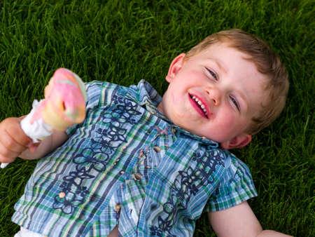 Boy eating ice cream photo