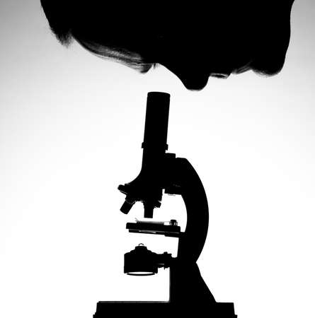 Man looking through microscope Stok Fotoğraf
