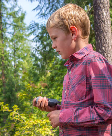 Child with a GPS device Stock Photo - 22101214