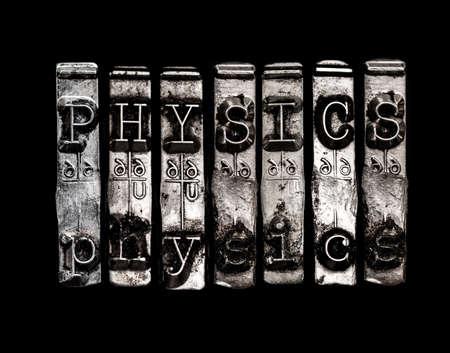 Physics word on typewriter keys Фото со стока
