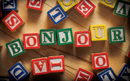 bonjour: Bonjour word on wooden blocks