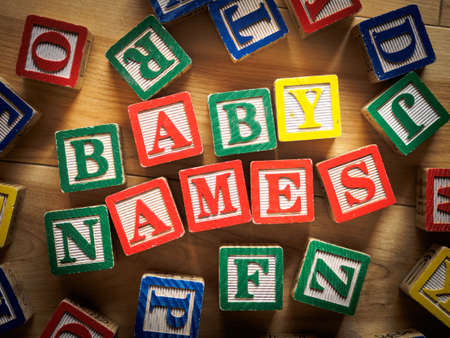 Baby names words on wooden blocks Stockfoto