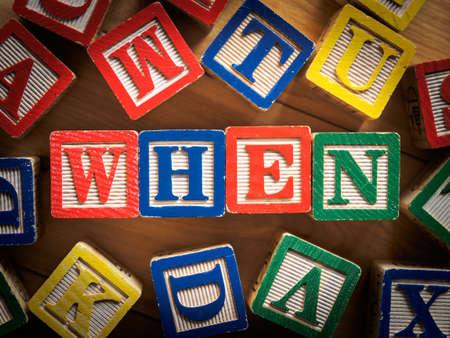 when: When word on wooden blocks