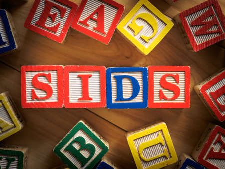 suffocate: SIDS - Sudden infant death syndrome on wooden blocks Stock Photo