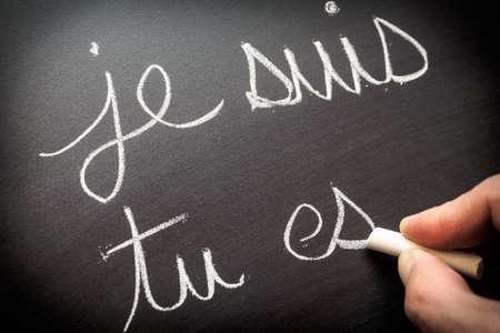Conjugating verbs in French Foto de archivo