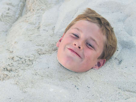 Buried in the sand photo