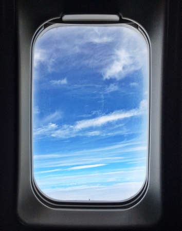 Sunny sky outside airplane window photo