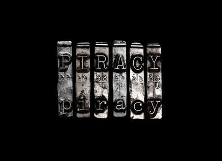 piracy: Piracy concept in metal type letters Stock Photo