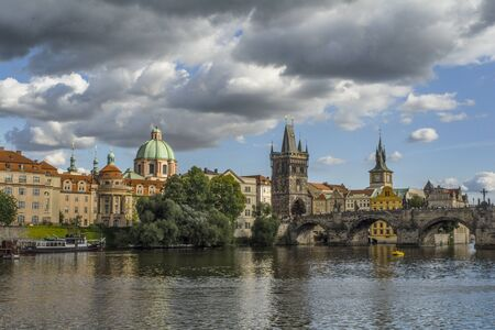 vltava river: Cruising the Vltava River in Prague, Czech Republic on a beautiful day mixed with sun and clouds.