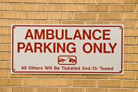 Ambulance parking only sign Stock Photo