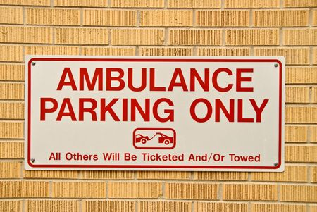 A sign indicating a ambulance parking only zone.