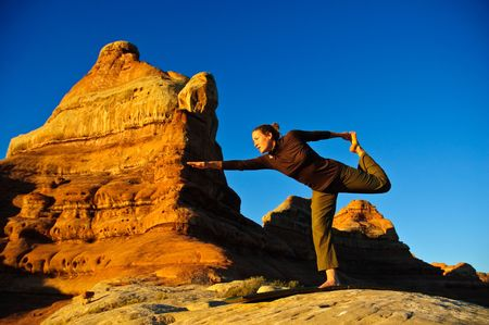 A woman doing yoga in Canyon Lands National Park.