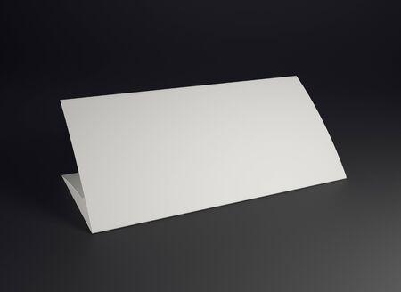 folded: Mock up white folded paper on black background. Close up.
