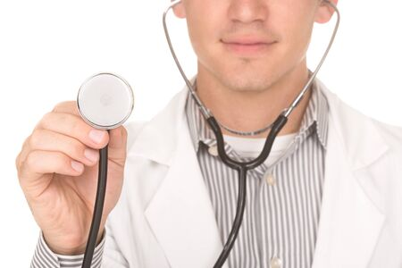 Doctor holding a stethoscope up.