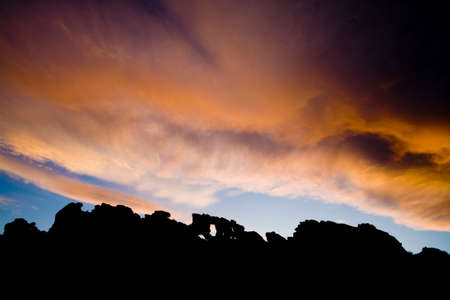 loveland: The sun sets behind The Keystone, a natural rock arch at Devils Backbone Open Space in Loveland, Colorado.