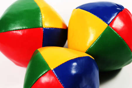 vividly: three vividly colored juggling balls in a central grouping