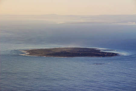 The view of Robben Island from the top of Table Mountain at Sunset Stock Photo