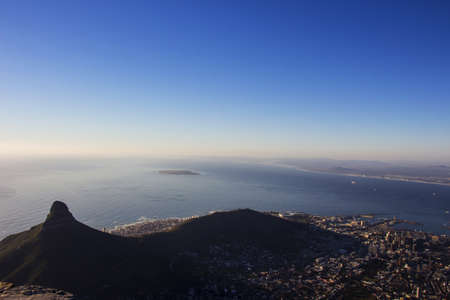 robben island: The view of Lion s Head, part of the city of Cape Town and Robben Island from the top of Table Mountain at Sunset Stock Photo