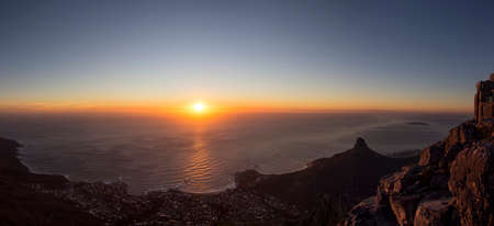 robben island: A Panorama of Clifton Beach and Camps Bay in Cape Town From Table Mountain at Sunset Stock Photo