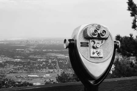 operated: Coin operated binoculars looking over Denver
