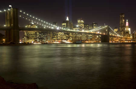 The Brooklyn Bridge and lower Manhattan at night.