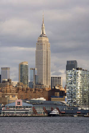 The Empire State Building, Chelsea and the Hudson River show in this skyline of New York City. photo