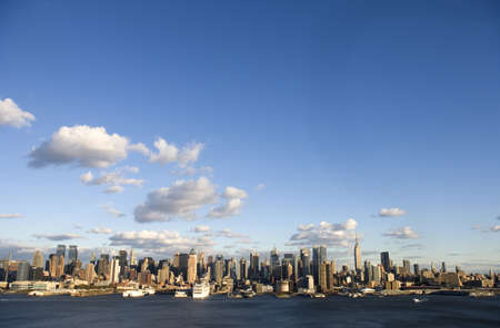 The skyline of the west side of New York City, Midtown from roughly Soho to the upper 70s. Includes the Intrepid, Cruise Ships, the Empire State Building, the Hudson River and room for text.