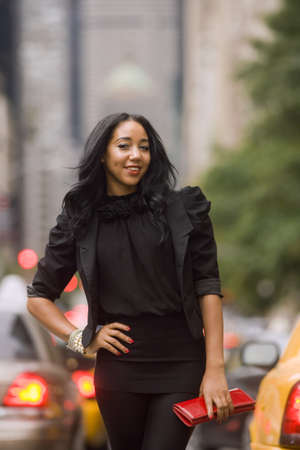 Smiling African-American woman on city street with blurred background Stock Photo - 10934881
