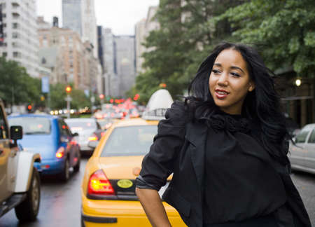 Smiling African-American woman on city street with blurred background Stock Photo - 10934882