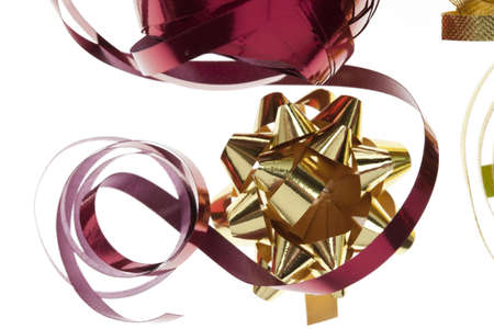 close-up of red ribbon and a gold bow.  For gift wrapping Stock Photo