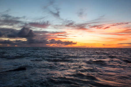 A tropical sunset over the Indian Ocean off the coast of Bali, Indonesia, southeast Asia   Choppy water in the foreground  Lots of room for text and dreams
