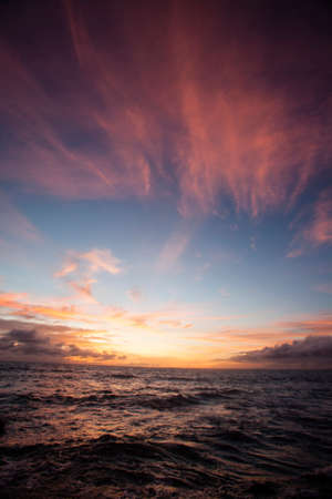 Sunset turns the sky a bright red over the Indian Ocean off Bali, Indonesia, south east Asia