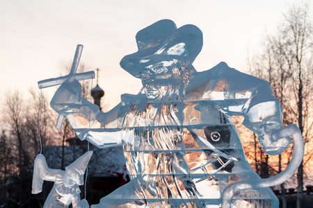 Karabas-Barabas. Ice sculpture-evil puppeteer controls a puppet on the background of a religious temple. Concept: religion is control of people, manipulation of believers.