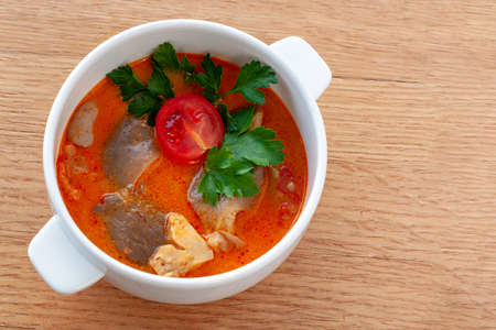 Vegetarian dish. Vegetarian soup Tom Yam with coconut milk, mushrooms, lemongrass and cherry tomatoes. Stock Photo