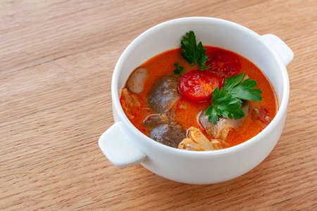 Vegetarian dish. Vegetarian soup Tom Yam with coconut milk, lemongrass, mushrooms, and cherry tomatoes.