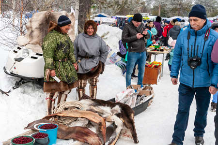 Russkinskaya, Surgut, Russia, 03/23/2019: open traditional holiday of reindeer herders and fishermen, indigenous peoples of Siberia. Local aborigines sell berries, meat and skins of deer, fish Editoriali