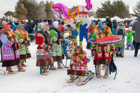 Russkinskaya, Surgut, Russia, 03/23/2019: open traditional holiday of reindeer herders and fishermen, indigenous peoples of Siberia. Demonstration of national costumes, aborigines of Siberia.