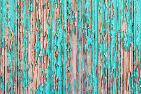 Vertical seamless frieze surface made of old boards, covered with peeling turquoise paint. Wooden background with shabby paint. Seamless wooden fence.