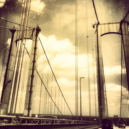 Crossing the bridge to Atlantic city. Sepia tone with light scratches to create an older looking image.