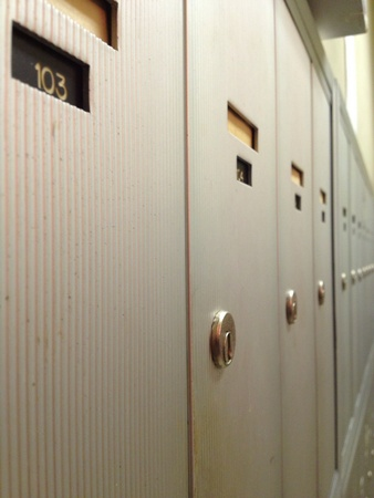 A line of mailboxes in an apartment complex.